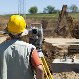 man surveying construction site